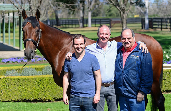 The Crismale family and Colm Santry  with American Pharoah.