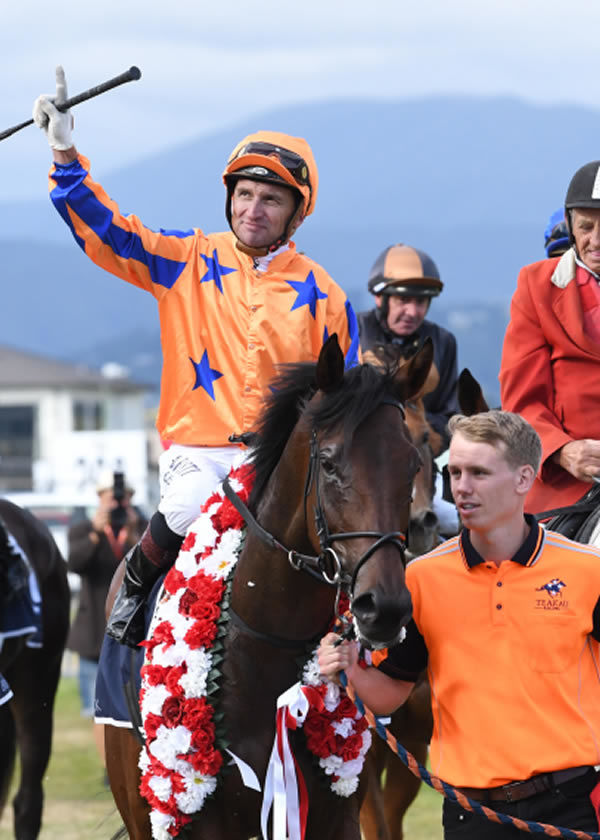 Opie Bosson salutes as he brings Amarelinha back to the Trentham birdcage Photo Credit: Race Images – Peter Rubery